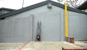Handstand, person standing upside down, Concrete wall, Camouflage